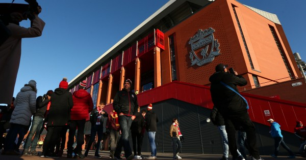 LIVERPOOL, ENGLAND - OCTOBER 27:  Fans walk outside the stadium prior to the Premier League match between Liverpool FC and Tottenham Hotspur at Anfield on October 27, 2019 in Liverpool, United Kingdom. (Photo by Jan Kruger/Getty Images)