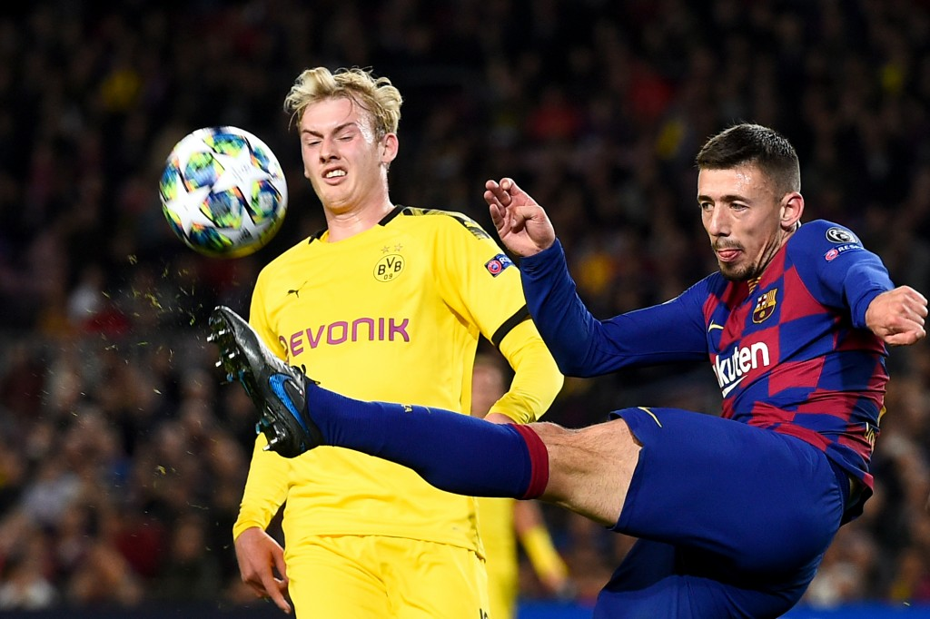 Barcelona's French defender Clement Lenglet (R) kicks the ball next to Dortmund's German forward Julian Brandt during the UEFA Champions League Group F football match between FC Barcelona and Borussia Dortmund at the Camp Nou stadium in Barcelona, on November 27, 2019. (Photo by Josep LAGO / AFP) (Photo by JOSEP LAGO/AFP via Getty Images)