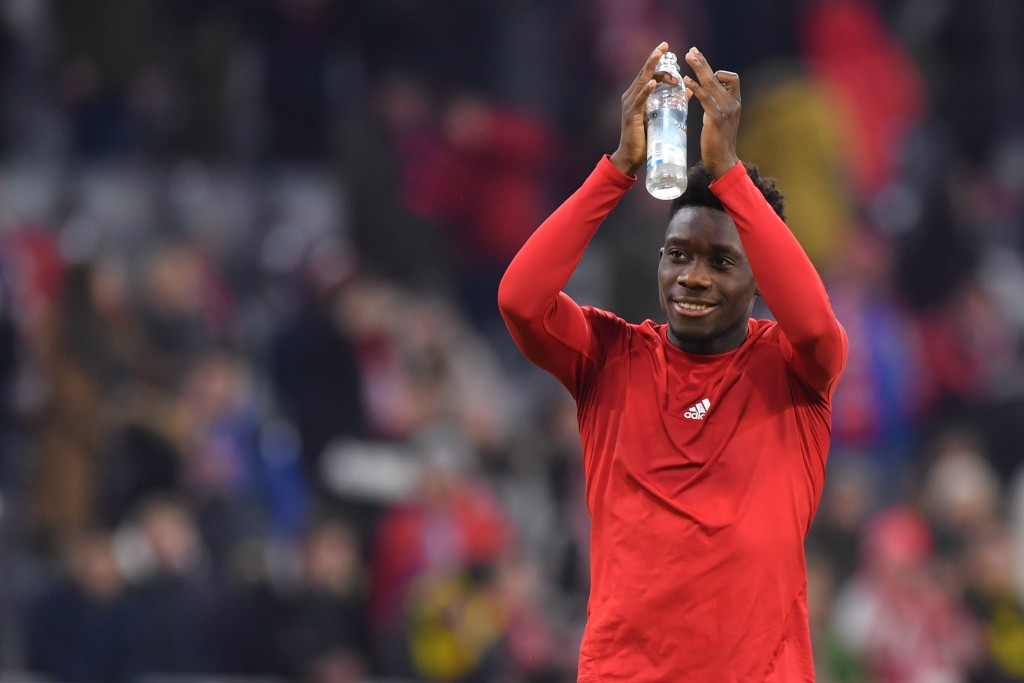 MUNICH, GERMANY - NOVEMBER 09: Alphonso Davies of Bayern Muenchen applauds after the Bundesliga match between FC Bayern Muenchen and Borussia Dortmund at Allianz Arena on November 09, 2019 in Munich, Germany. (Photo by Sebastian Widmann/Bongarts/Getty Images)