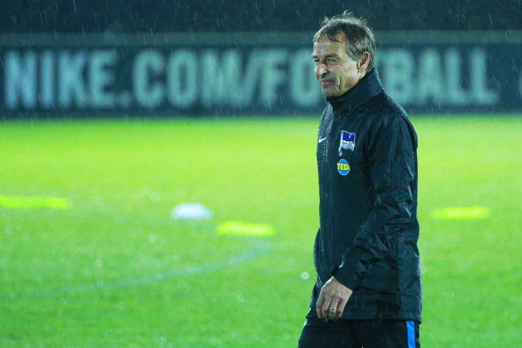 BERLIN, GERMANY - NOVEMBER 27: Juergen Klinsmann walks on the lawn during a training session on November 27, 2019 in Berlin, Germany. (Photo by Christian Marquardt/Bongarts/Getty Images)