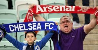 An Arsenal and a Chelsea supporter hold team scarves prior to the UEFA Europa League final football match between Chelsea FC and Arsenal FC at the Baku Olympic Stadium in Baku, Azerbaijian, on May 29, 2019. (Photo by Kirill KUDRYAVTSEV / AFP) (Photo credit should read KIRILL KUDRYAVTSEV/AFP via Getty Images)