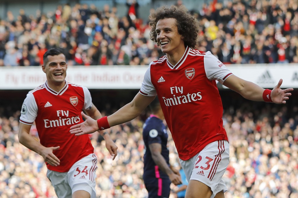 Asenal's Brazilian defender David Luiz (R) celebrates with Arsenal's Swiss midfielder Granit Xhaka (L) after scoring the opening goal of the English Premier League football match between Arsenal and Bournemouth at the Emirates Stadium in London on October 6, 2019. (Photo by Tolga AKMEN / AFP) / RESTRICTED TO EDITORIAL USE. No use with unauthorized audio, video, data, fixture lists, club/league logos or 'live' services. Online in-match use limited to 120 images. An additional 40 images may be used in extra time. No video emulation. Social media in-match use limited to 120 images. An additional 40 images may be used in extra time. No use in betting publications, games or single club/league/player publications. / (Photo by TOLGA AKMEN/AFP via Getty Images)