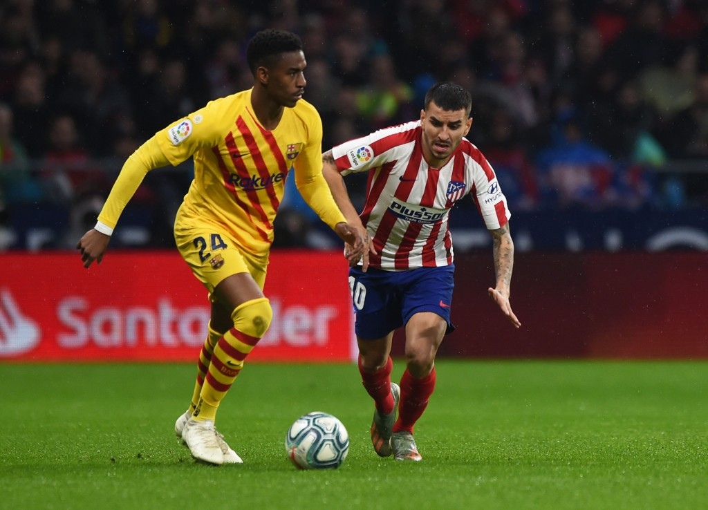 MADRID, SPAIN - DECEMBER 01: Junior Firpo of FC Barcelona holds off Angel Correa of Atletico Madrid during the Liga match between Club Atletico de Madrid and FC Barcelona at Wanda Metropolitano on December 01, 2019 in Madrid, Spain. (Photo by Denis Doyle/Getty Images)