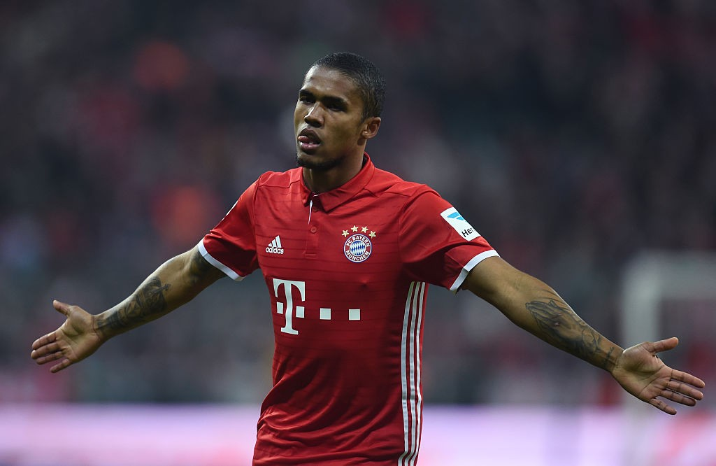 Douglas Costa had a sour end to his Bayern stint. (Photo credit should read CHRISTOF STACHE/AFP via Getty Images)
