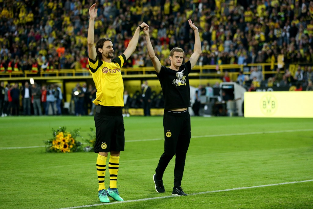 DORTMUND, GERMANY - SEPTEMBER 07: (L-R) Neven Subotic and Sven Bender of Dortmund say farewell to the fans during the Roman Weidenfeller Farewell Match between Borussia Dortmund Allstars and Roman and Friends at Signal Iduna Park on September 7, 2018 in Dortmund, Germany. (Photo by Christof Koepsel/Bongarts/Getty Images)