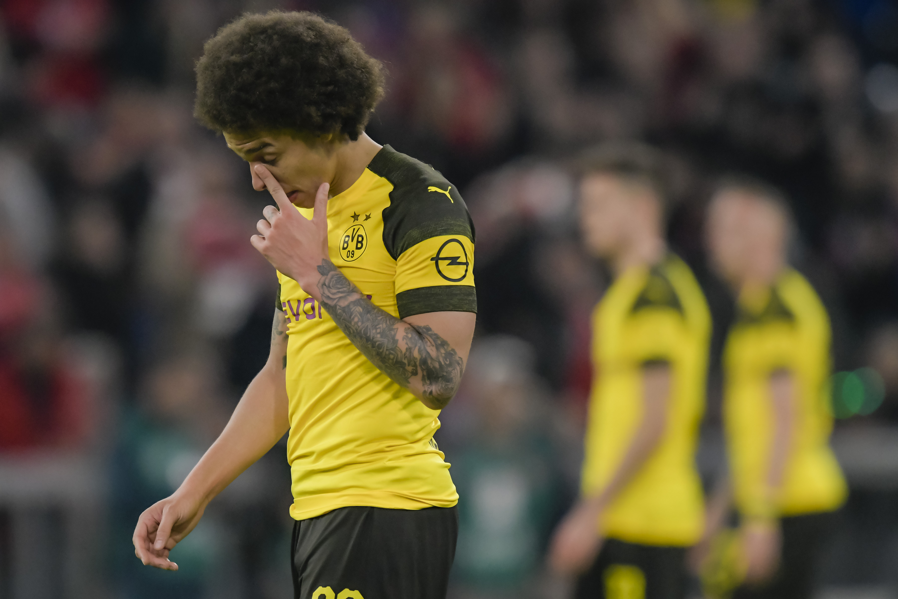 Axel Witsel misses out with an injury (Photo by Guenter SCHIFFMANN / AFP) / RESTRICTIONS: DFL REGULATIONS PROHIBIT ANY USE OF PHOTOGRAPHS AS IMAGE SEQUENCES AND/OR QUASI-VIDEO (Photo credit should read GUENTER SCHIFFMANN/AFP via Getty Images)