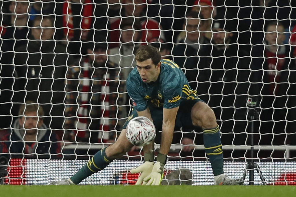 Arsenal's Argentinian goalkeeper Emiliano Martinez makes a save during the English FA Cup third round football match between Arsenal and Leeds United at The Emirates Stadium in London on January 6, 2020. (Photo by Adrian DENNIS / AFP) / RESTRICTED TO EDITORIAL USE. No use with unauthorized audio, video, data, fixture lists, club/league logos or 'live' services. Online in-match use limited to 120 images. An additional 40 images may be used in extra time. No video emulation. Social media in-match use limited to 120 images. An additional 40 images may be used in extra time. No use in betting publications, games or single club/league/player publications. / (Photo by ADRIAN DENNIS/AFP via Getty Images)