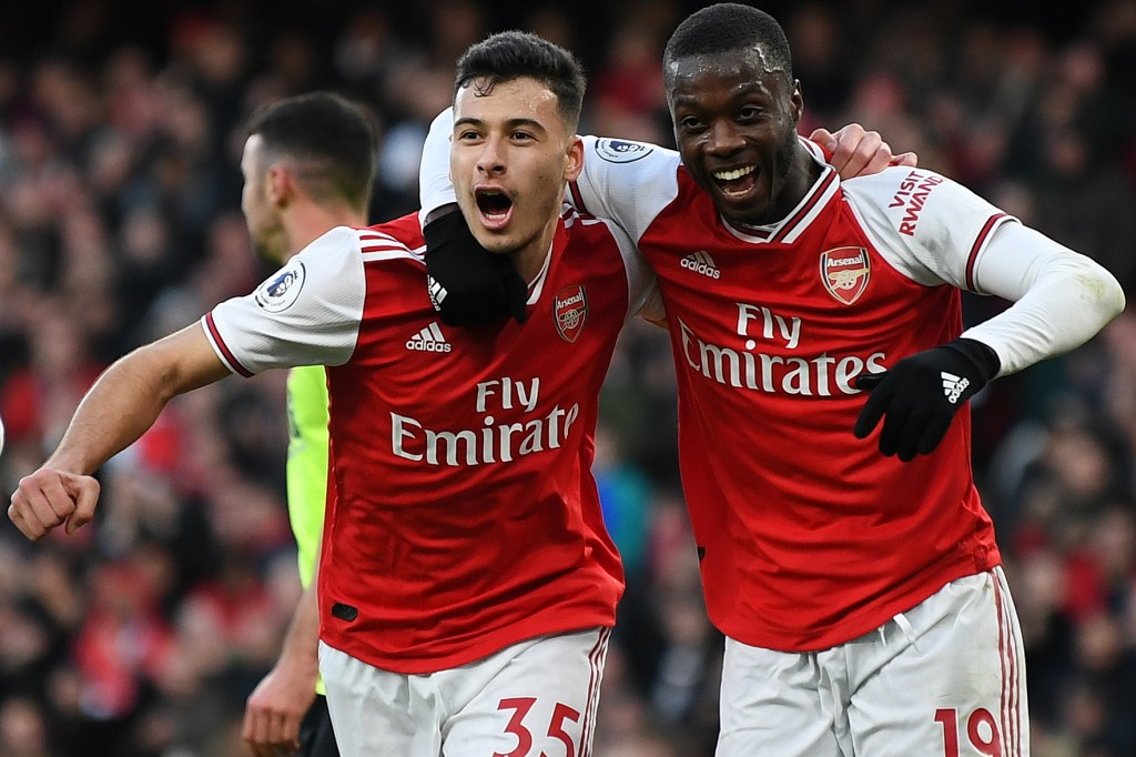Nicolas Pepe and Gabriel Martinelli are two of ten possible absentees for Arsenal against Wolves. (Photo by Daniel Leal-Olivas/AFP via Getty Images)