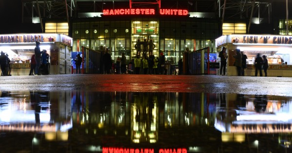 MANCHESTER, ENGLAND - DECEMBER 18: General view outside the stadium as fans arrive prior to the Carabao Cup Quarter Final match between Manchester United and Colchester United at Old Trafford on December 18, 2019 in Manchester, England. (Photo by Clive Mason/Getty Images)