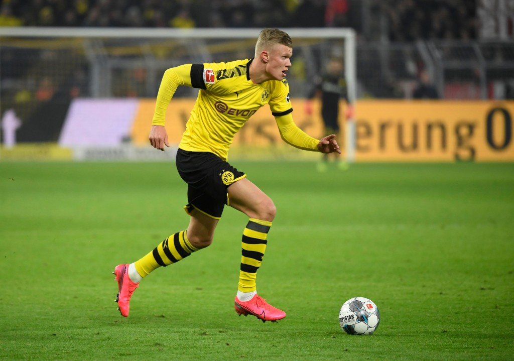 Dortmund's Norwegian forward Erling Braut Haaland runs with the ball during the German first division Bundesliga football match Borussia Dortmund v FC Cologne in Dortmund, on January 24, 2020. (Photo by Ina FASSBENDER / AFP) / DFL REGULATIONS PROHIBIT ANY USE OF PHOTOGRAPHS AS IMAGE SEQUENCES AND/OR QUASI-VIDEO (Photo by INA FASSBENDER/AFP via Getty Images)