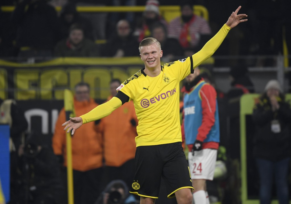 Dortmund's Norwegian forward Erling Braut Haaland celebrate scoring the 4-1 goal during the German first division Bundesliga football match Borussia Dortmund v FC Cologne in Dortmund, on January 24, 2020. (Photo by Ina FASSBENDER / AFP) / DFL REGULATIONS PROHIBIT ANY USE OF PHOTOGRAPHS AS IMAGE SEQUENCES AND/OR QUASI-VIDEO (Photo by INA FASSBENDER/AFP via Getty Images)