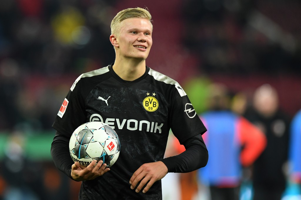 AUGSBURG, GERMANY - JANUARY 18: Erling Haaland of Borussia Dortmund holds the match ball after the Bundesliga match between FC Augsburg and Borussia Dortmund at WWK-Arena on January 18, 2020 in Augsburg, Germany. (Photo by Sebastian Widmann/Bongarts/Getty Images)