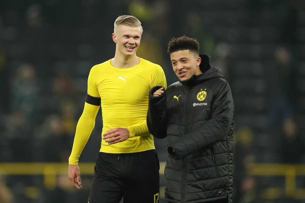 DORTMUND, GERMANY - JANUARY 24: Erling Haaland of Borussia Dortmund speaks with Jadon Sancho of Borussia Dortmund after the Bundesliga match between Borussia Dortmund and 1. FC Koeln at Signal Iduna Park on January 24, 2020 in Dortmund, Germany. (Photo by Lars Baron/Bongarts/Getty Images)