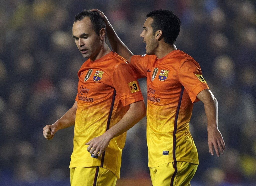 VALENCIA, SPAIN - NOVEMBER 25: Andres Iniesta (L) of Barcelona celebrates scoring with his teammate Pedro Rodriguez during the la Liga match between Levante UD and FC Barcelona at Ciutat de Valencia on November 25, 2012 in Valencia, Spain. (Photo by Manuel Queimadelos Alonso/Getty Images)