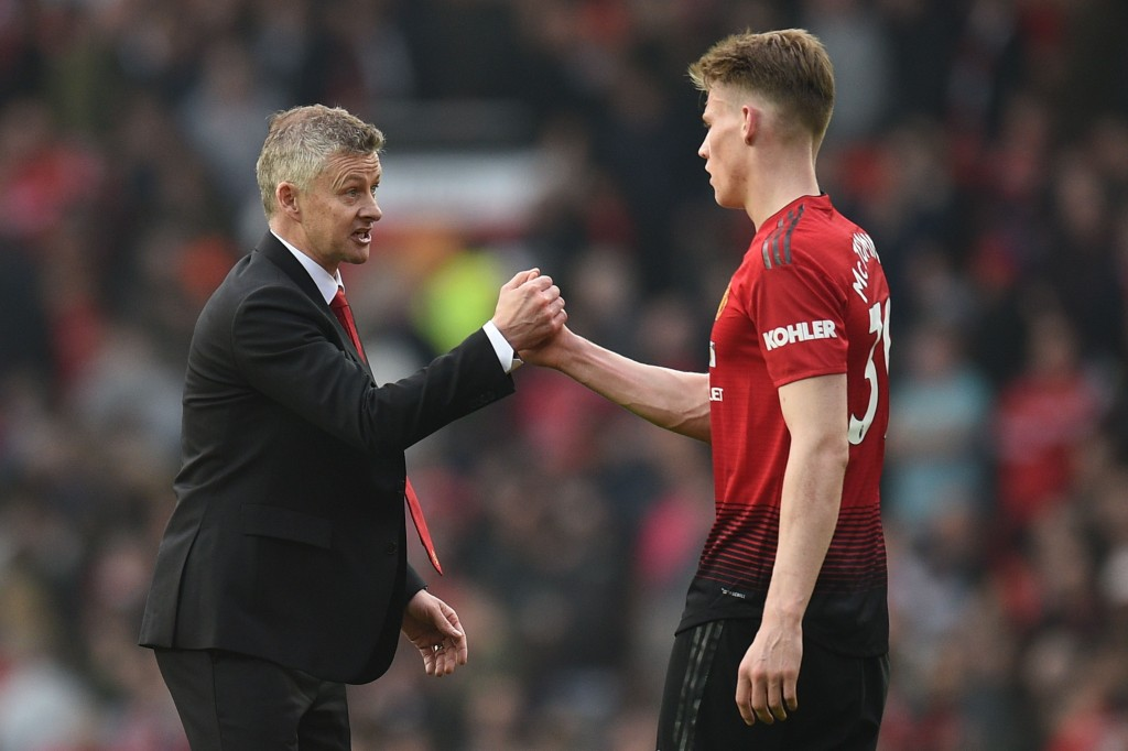 Manchester United's Norwegian caretaker manager Ole Gunnar Solskjaer (L) shakes hands with Manchester United's English midfielder Scott McTominay (R) after the final whistle of the English Premier League football match between Manchester United and Liverpool at Old Trafford in Manchester, north west England, on February 24, 2019. (Photo by Oli SCARFF / AFP) / RESTRICTED TO EDITORIAL USE. No use with unauthorized audio, video, data, fixture lists, club/league logos or 'live' services. Online in-match use limited to 120 images. An additional 40 images may be used in extra time. No video emulation. Social media in-match use limited to 120 images. An additional 40 images may be used in extra time. No use in betting publications, games or single club/league/player publications. / (Photo Oli Scarff/AFP via Getty Images)