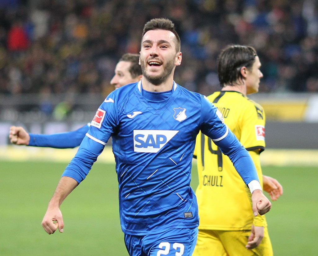 Hoffenheim's Armenian striker Sargis Adamyan celebrate scoring the 1-1 equalizer during the German First division Bundesliga football match TSG 1899 Hoffenheim v BVB Borussia Dortmund in Sinsheim, southern Germany, on December 20, 2019. (Photo by Daniel ROLAND / AFP) / DFL REGULATIONS PROHIBIT ANY USE OF PHOTOGRAPHS AS IMAGE SEQUENCES AND/OR QUASI-VIDEO (Photo by DANIEL ROLAND/AFP via Getty Images)