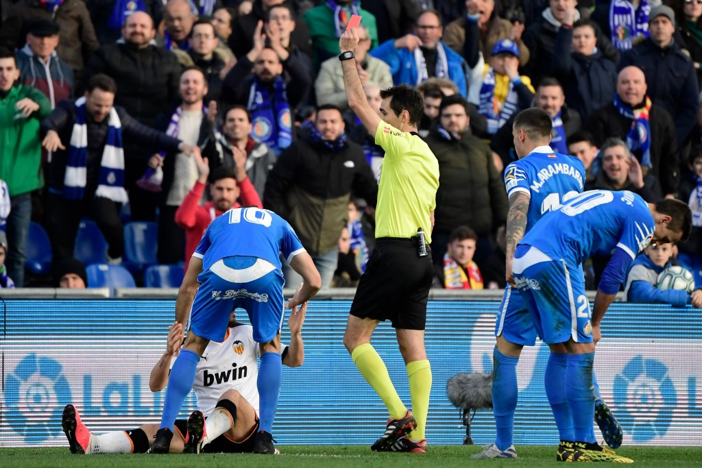 Alessandro Florenzi (in white) is suspended after being sent off against Getafe last week. (Photo by Javier Soriano/AFP via Getty Images)
