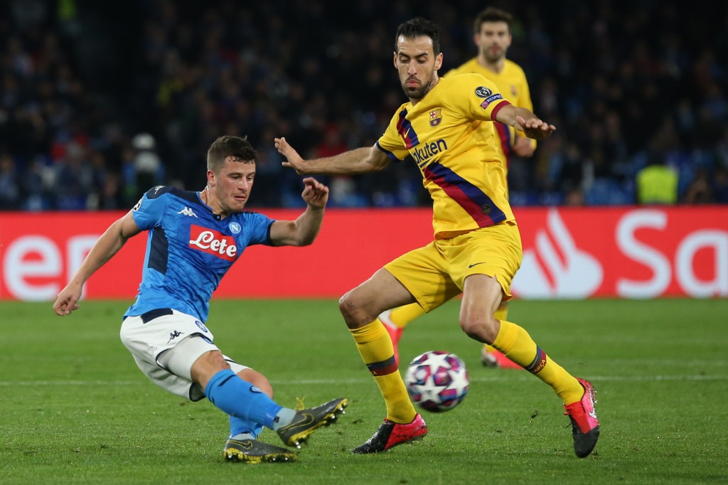 Napoli's German midfiedler Diego Demme (L) vies for the ball with Barcelona's Spanish midfielder Sergio Busquets during the UEFA Champions League round of 16 first-leg football match between SSC Napoli and FC Barcelona at the San Paolo Stadium in Naples on February 25, 2020. (Photo by CARLO HERMANN / AFP) (Photo by CARLO HERMANN/AFP via Getty Images)