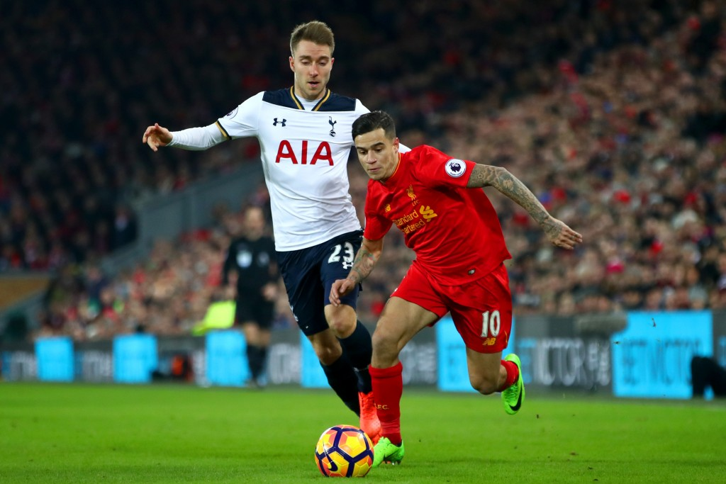 LIVERPOOL, ENGLAND - FEBRUARY 11: Philippe Coutinho of Liverpool and Christian Eriksen of Tottenham Hotspur compete for the ball during the Premier League match between Liverpool and Tottenham Hotspur at Anfield on February 11, 2017 in Liverpool, England. (Photo by Clive Brunskill/Getty Images)